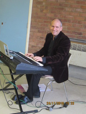 Mark Bussell playing keyboard at our November meeting.